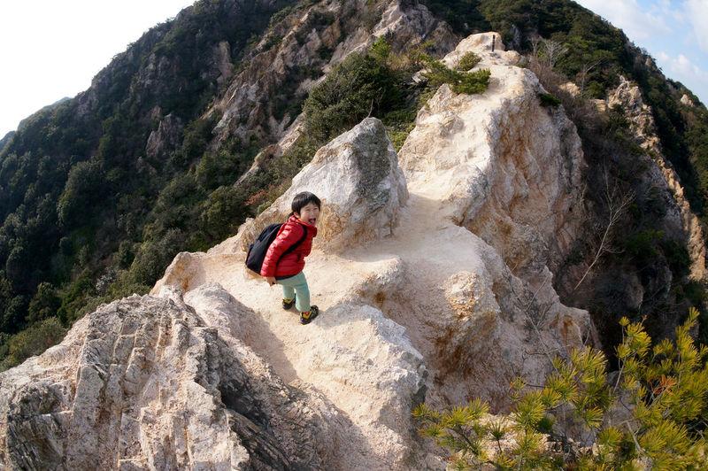 Child hiking on mountain