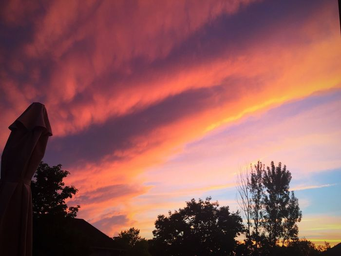 Post Storm Sky Sunset Beauty In Nature Outdoors Bright Colors Nature Serenebeauty I Love Nature! Naturally Beautiful  Back Deck View Silhouette Cloud - Sky Tree Scenics Low Angle View Tranquility No People Tranquil Scene