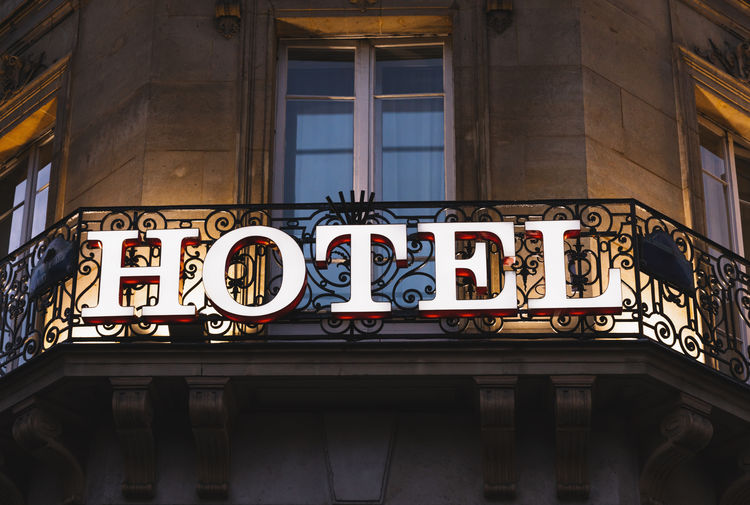 Illuminated hotel sign taken in Paris at night Architecture Business Entrance Façade France Holiday Light Luxery Paris Reception Service Sign Balcony Commercial Communication Europe Hotel Illuminated Journey Marketing Motel Resort Tourism Vacation Welcome