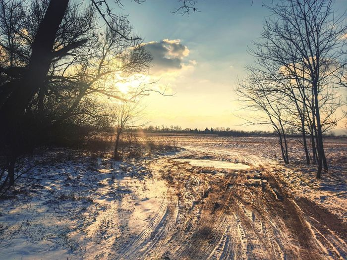 Scenic view of snow field against sky during sunset