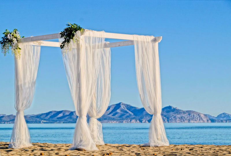 Tranquility Wedding Photography Baldachine Beach Beauty In Nature Blue Blue Sky Day Horizon Over Water Mountain Nature No People Outdoors Sky Summer Tranquil Scene Water Wedding Baldachine