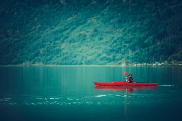 Man kayaking on lake