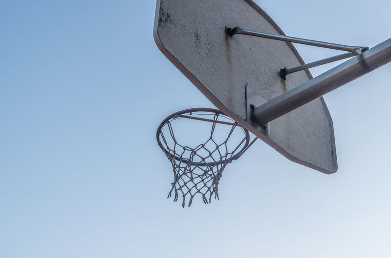 Basketball Basketball - Sport Basketball Hoop Blue Clear Sky Close-up Court Day Leisure Games Low Angle View Making A Basket No People Outdoors Sky Sport