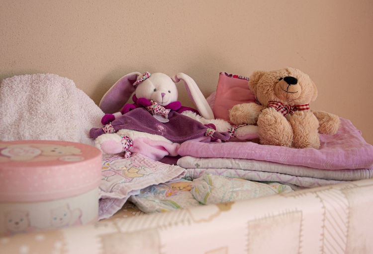Close-up of stuffed toy on bed at home