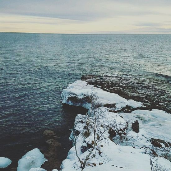 Nature Outdoors Beauty In Nature Winter Tranquility Travel Destinations Cold Temperature Sky Beach Tranquil Scene Landscape No People Water Day Backgrounds Lake Superior Maximum Closeness Beauty In Nature Freshness Rocky Stone - Object DuluthMN Minnesota Nature Amateurphotography Lost In The Landscape EyeEmNewHere Shades Of Winter The Great Outdoors - 2018 EyeEm Awards