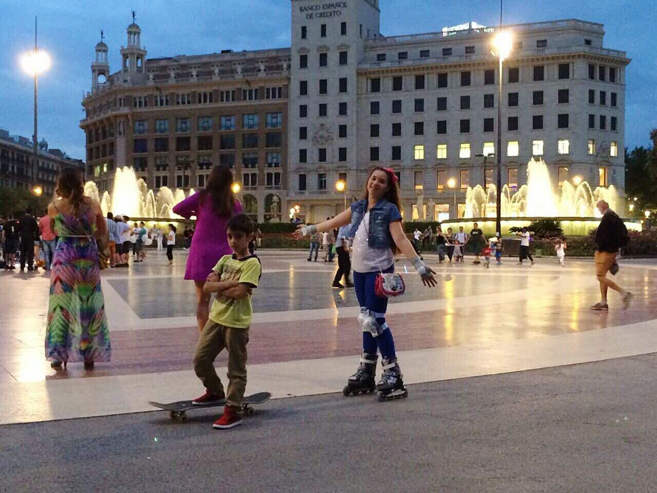 architecture, building exterior, built structure, real people, leisure activity, walking, outdoors, large group of people, illuminated, men, lifestyles, full length, women, city, day, ice-skating, ice rink, sky, people, adult