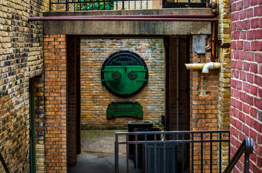 Architecture Brick Brick Wall Building Building Exterior Built Structure Close-up Communication Day Focus On Foreground Green Color Metal No People Old Outdoors Technology Wall Wall - Building Feature Window