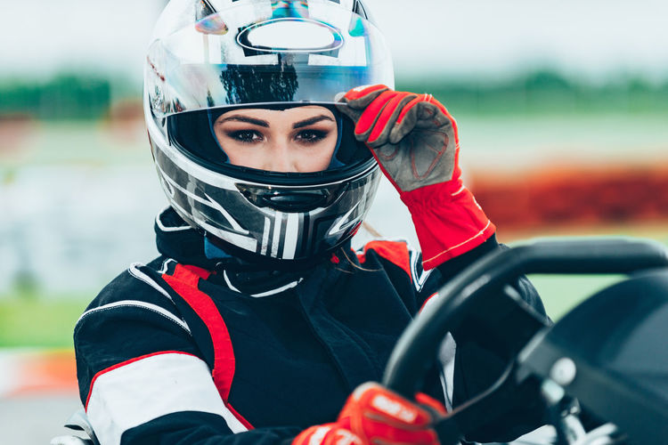 Woman Driving Go-Cart Go-carting Carting Champ Car Racing Soapbox Chart Chart Car Competitive Sport Motorsport Driver Drive Speed Sport Sport Race Motor Racing Track Activity Young Woman Driving Sports Uniform Sports Helmet Lifestyle Car Racing Fun