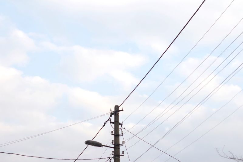 EyeEm Selects Sky Cloud - Sky Cable Technology Low Angle View Electricity  Connection Power Line  No People Electricity Pylon Day Power Supply Outdoors Complexity Built Structure Communication Electrical Equipment Telephone Pole Fuel And Power Generation