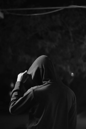 Rear view of man standing at night