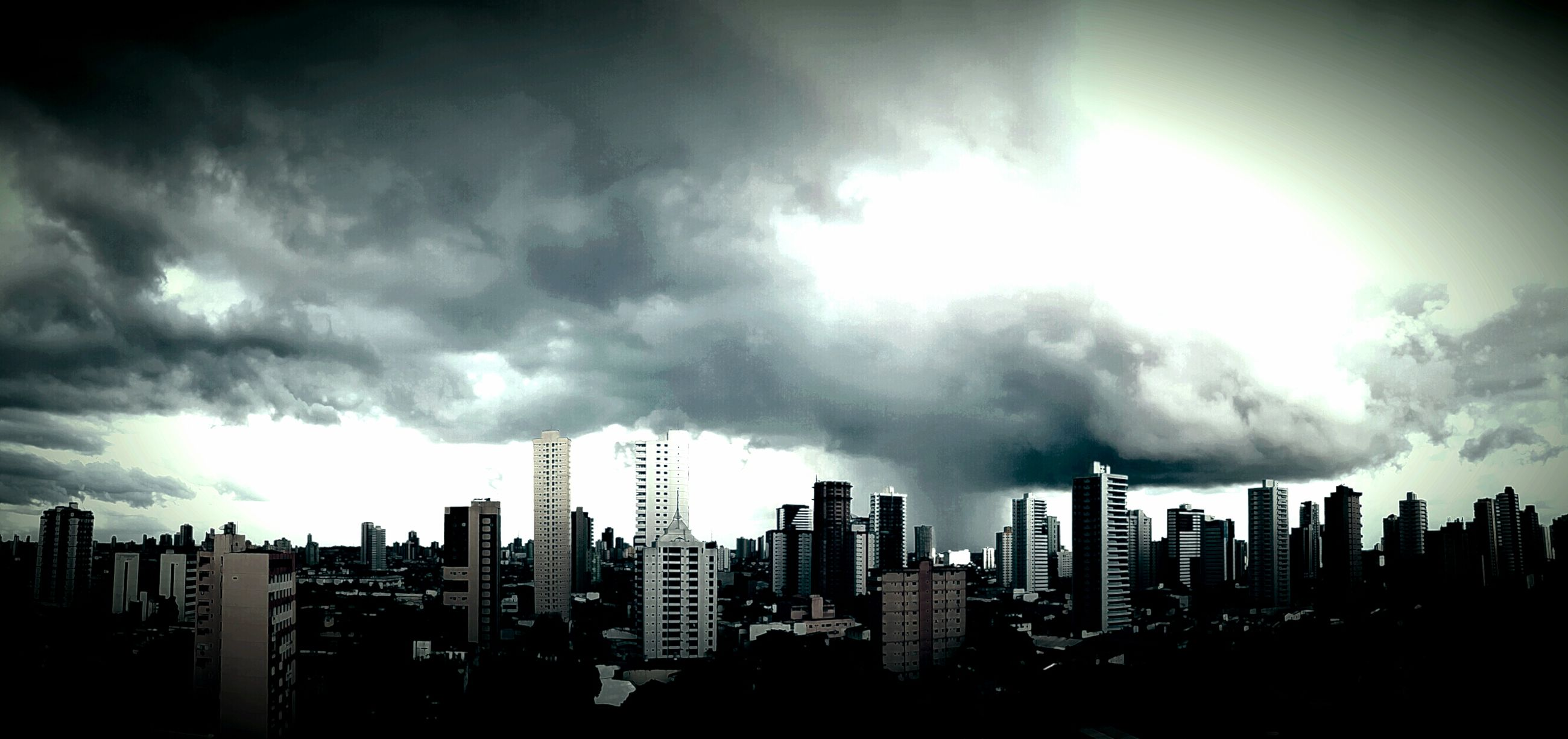 sky, city, building exterior, cloud - sky, cityscape, architecture, urban skyline, outdoors, no people, skyscraper, silhouette, built structure, storm cloud, nature, day