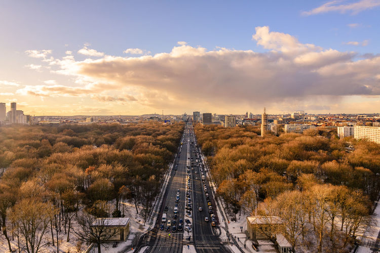 Aerial panoramic view, cityscape of berlin in winter season at tiergarten park during sunset.