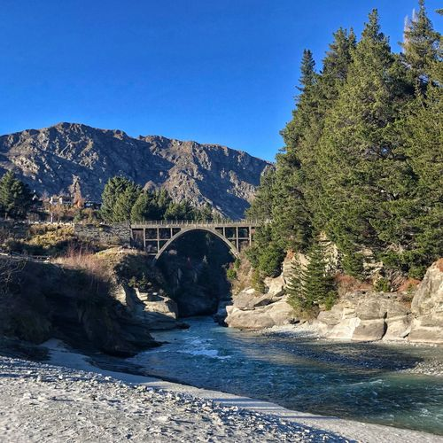 I wish I could tell you how I feel Bridge Bridge Over Water Bridge - Man Made Structure Riverscape Riverside Riverside River New Zealand Scenery Queenstown, NZ IPhoneography Sky Plant Tree Sunlight Nature Blue Beauty In Nature No People Outdoors Mountain Architecture