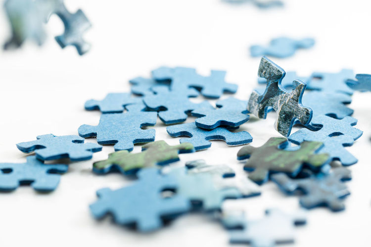 Blue Close-up Connection Indoors  Jigsaw Piece Jigsaw Puzzle Large Group Of Objects Leisure Activity Leisure Games No People Pattern Puzzle  Relaxation Selective Focus Solution Still Life Strategy Studio Shot Surface Level Toy White Background