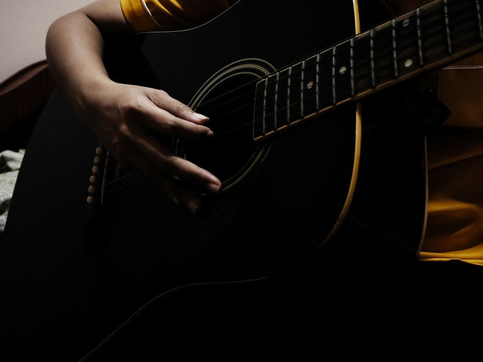 Music Musical Instrument Arts Culture And Entertainment Guitar String Instrument Playing Musical Equipment Musician One Person Human Hand Artist Hand Human Body Part Indoors  Real People Guitarist Musical Instrument String Lifestyles Holding Skill  Plucking An Instrument Electric Guitar Acoustic Guitar Finger Rock Music
