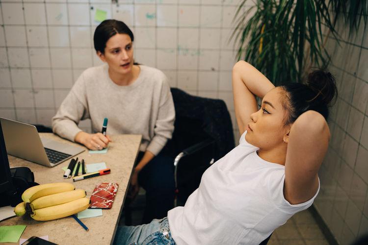 Women sitting on table