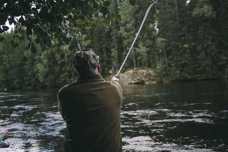 Rear view of man fishing