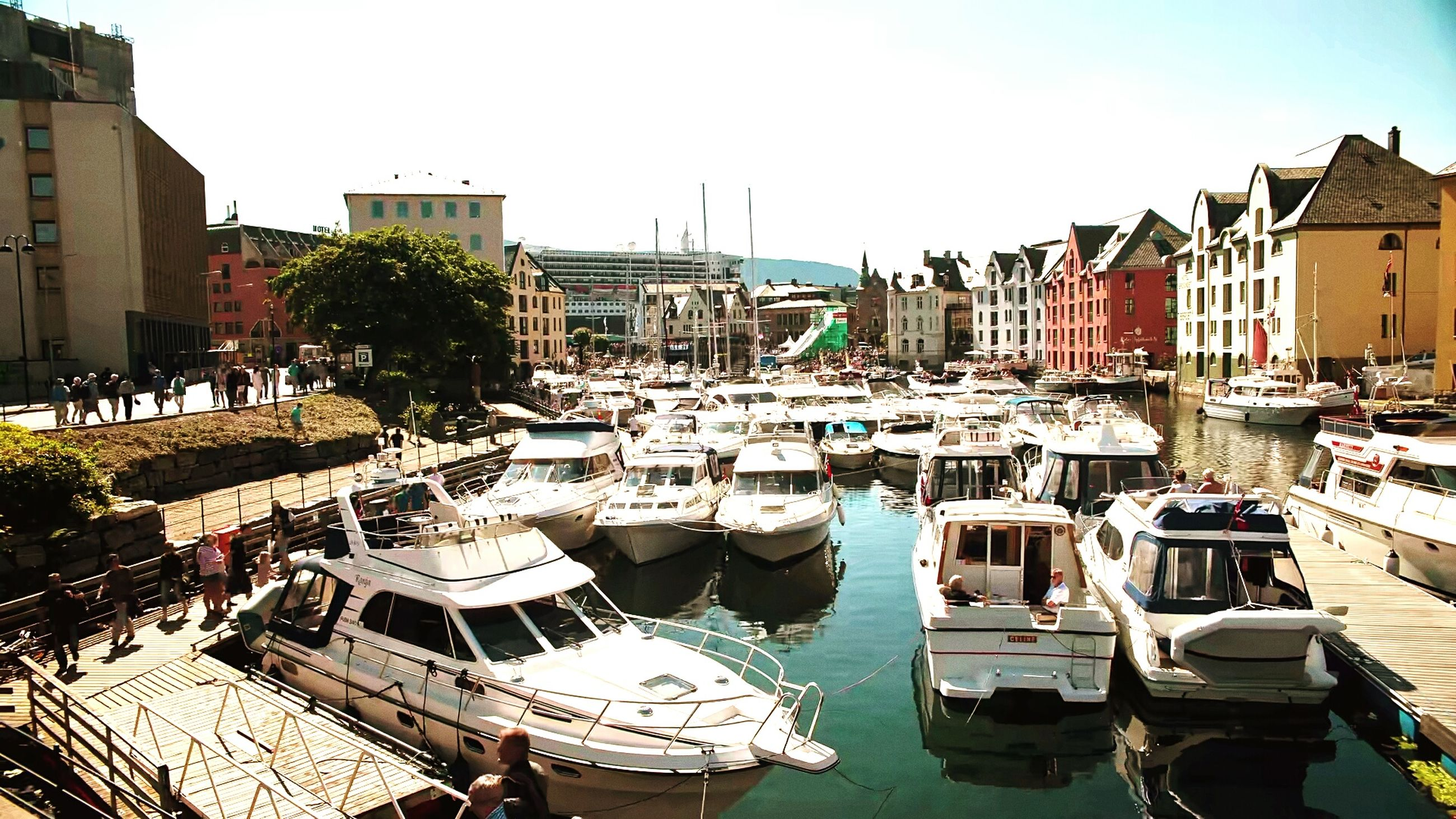 building exterior, nautical vessel, architecture, moored, built structure, boat, water, transportation, mode of transport, harbor, city, residential building, high angle view, residential structure, canal, clear sky, sea, house, town, sky