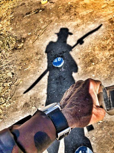 High angle view of man shadow on hand