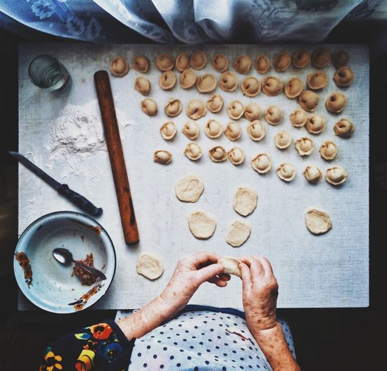 Cropped image of woman making snacks of dough