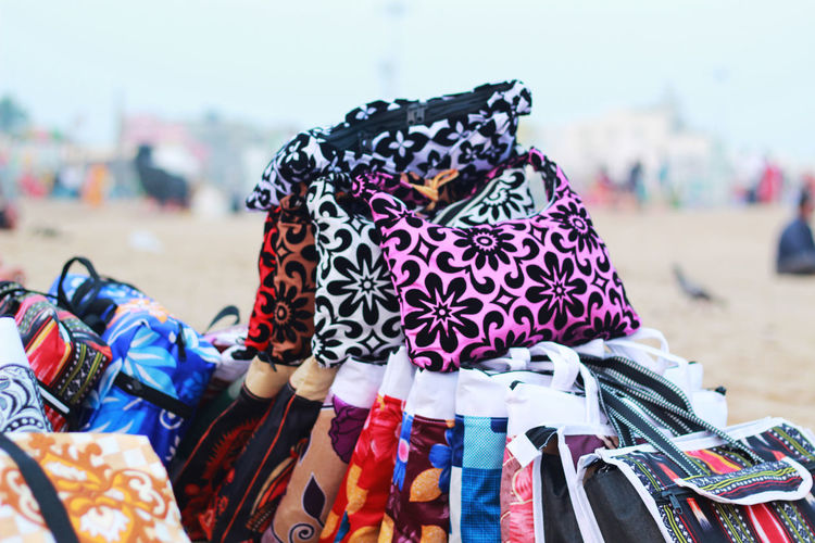 hep of bag at sea beach Focus On Foreground Clothing Day Pattern For Sale Incidental People Retail  Bag Market Close-up Multi Colored Market Stall Outdoors Choice Variation Retail Display Women Floral Pattern Sale Scarf