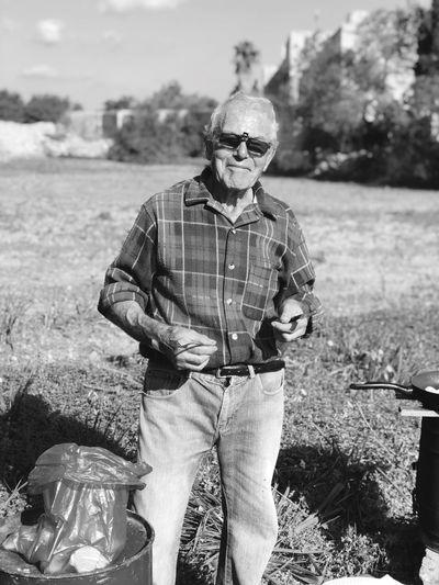 Senior man standing on field