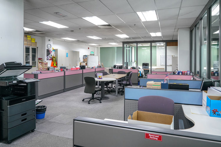 Empty chairs and tables in office
