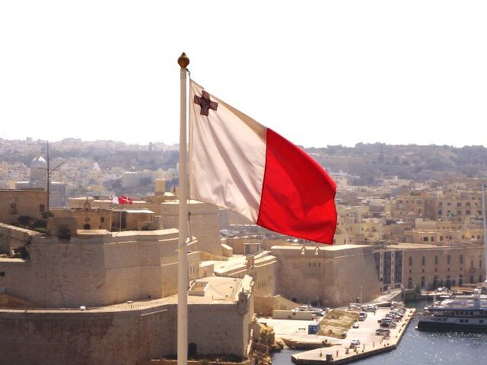 The beautiful Island of Malta's national flag over the Grand Harbour Patriotism Red Clear Sky Architecture Built Structure No People City Outdoors Flag Sky Day