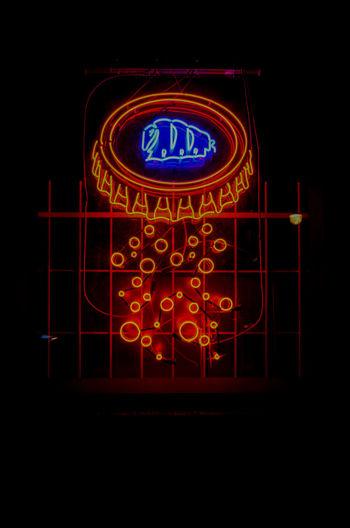 Neon Black Background Illuminated Clock Face Red Close-up Lighting Equipment