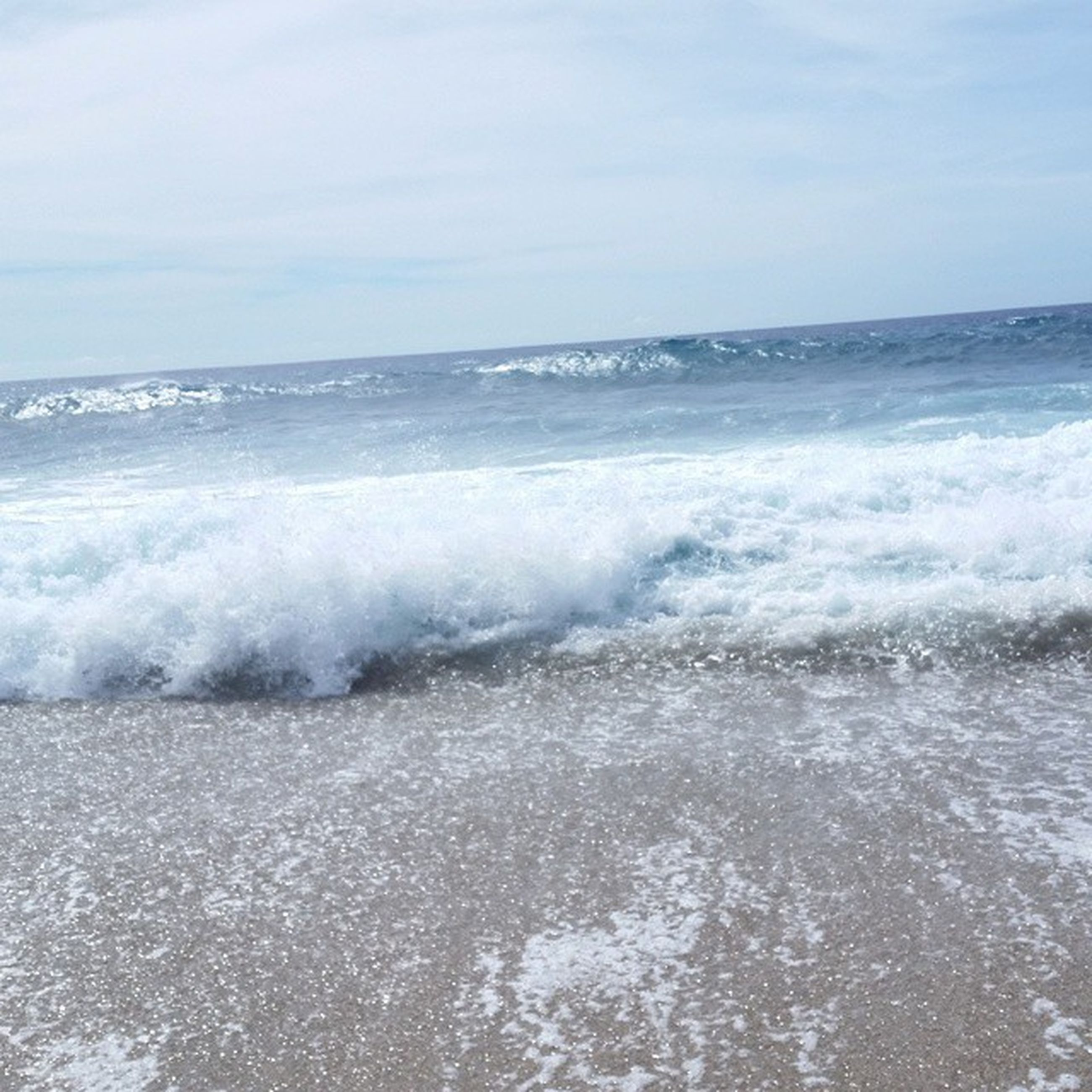 sea, water, horizon over water, wave, surf, beach, scenics, shore, motion, beauty in nature, sky, nature, splashing, tranquil scene, tranquility, tide, idyllic, power in nature, seascape, sand
