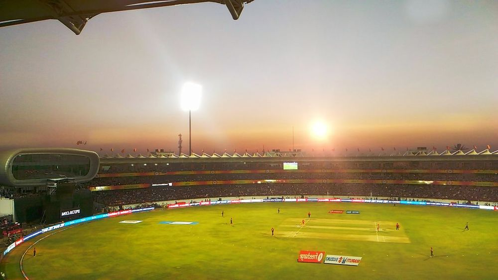 Stadium Playing Field Sport Outdoors Sports Venue Match - Sport Grass People Large Group Of People Night Crowd Fan - Enthusiast Sky Adult Sunsetphotographs Sunset_collection Sunshine Sunsets Cricket Match Cricketer Cricket Stadium Cricket Ground