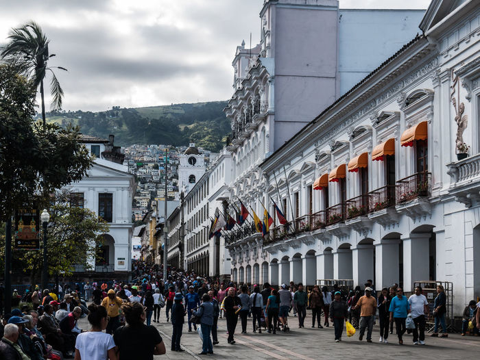 QUITO, ECUADOR - AUGUST 10, 2018: People begin filling up Quito's downtown area to celebrate Ecuador's independence day. Celebration Downtown Event Holiday Independence Old Town Quito Traveling Adult Architecture Building Building Exterior Built Structure City Crowd Ecuador Group Of People Independence Day Large Group Of People Men People Real People Sky Street Women
