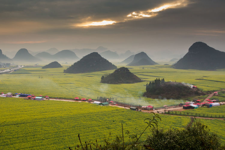 Beauty In Nature Mountain Sky Scenics - Nature Environment Landscape Plant Land Cloud - Sky Field Tranquil Scene Grass Nature Sunset Green Color Mountain Range Tranquility Agriculture Idyllic Growth No People Outdoors