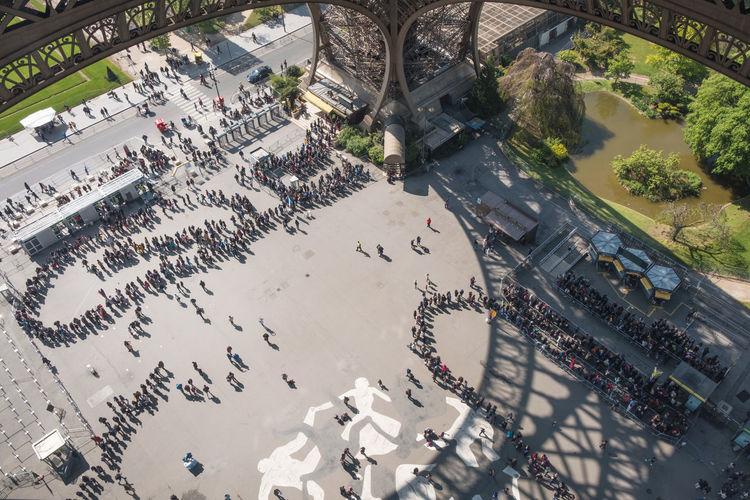High Angle View Of People Below Eiffel Tower