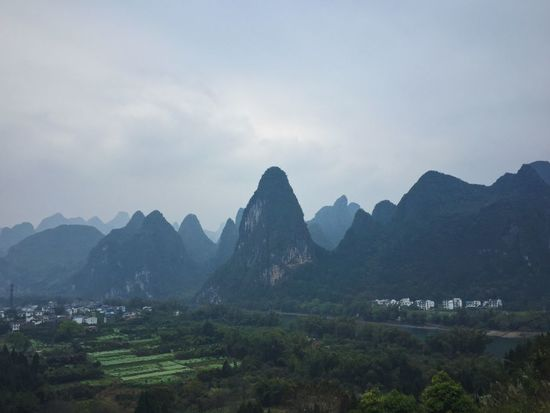 The village in YangShuo Mountain Mountain Range Sky Building Exterior Beauty In Nature Architecture Scenics Nature Built Structure No People Tree Outdoors Landscape Day Yangshuo YangSh
