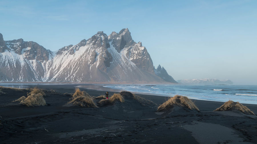 Winter Beach Beauty In Nature Black Sand Beach Iceland Cold Temperature Day Mountain Nature One Person Outdoors Scenics Sea Sky Snow Tranquility Water