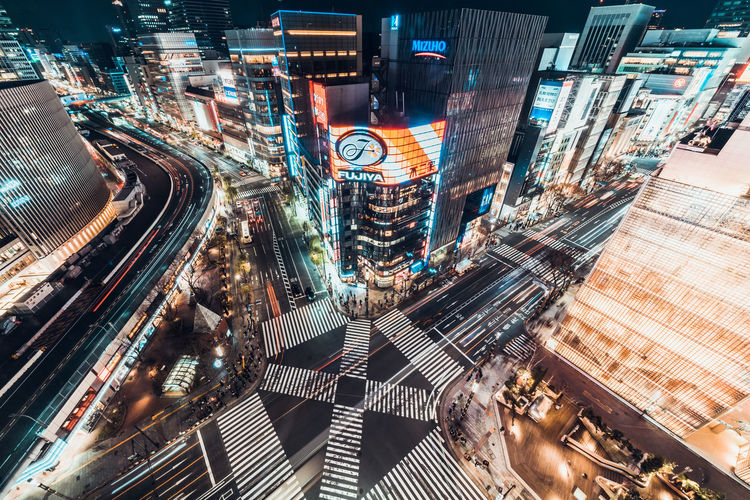 Tokyo, Japan - Jan 13, 2019: Cityscape aerial night view of Ginza zebra crosswalk road intersection with car traffic and pedestrians. Tokyo business and shopping district or Japanese city life concept Japan Ginza Tokyo Tokyo,Japan Ginza Tokyo Japan Crosswalk Scramble Crossing Crossing Road Transportation Street City Cityscape Night Cars Building Shopping Shopping Mall Travel Destinations Tourist Attraction  Traffic ASIA Travel Business Intersection