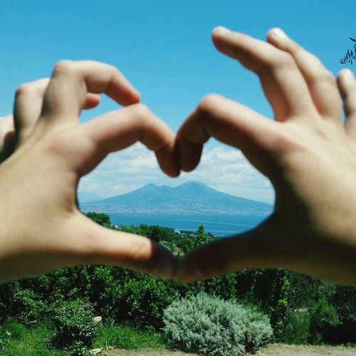 Panoramic view with hands forming heart