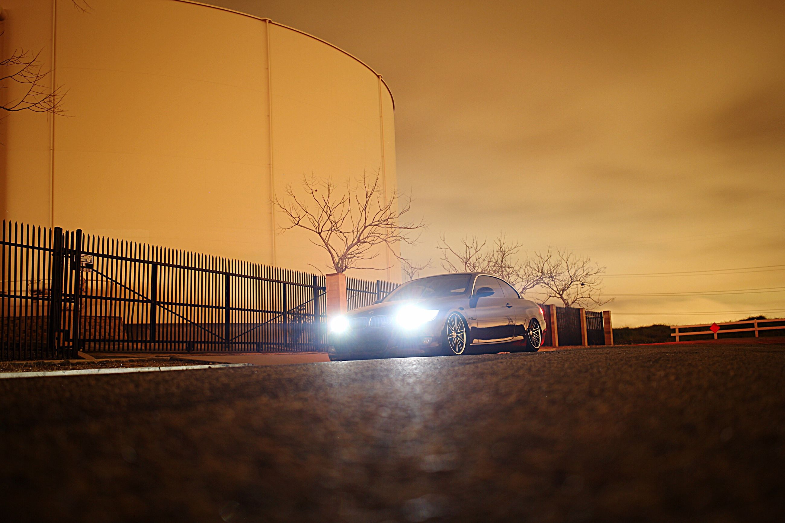 car, road, illuminated, no people, built structure, outdoors, night, architecture, sky