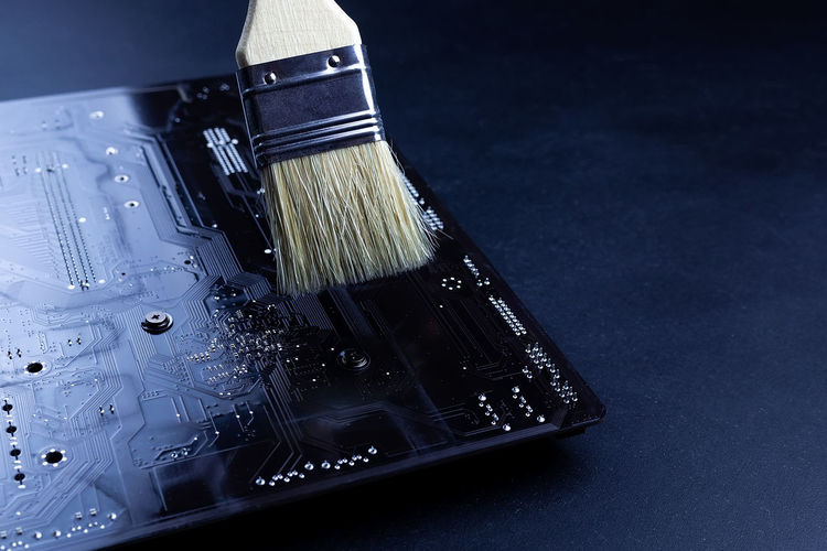 High angle view of paintbrushes on table against black background