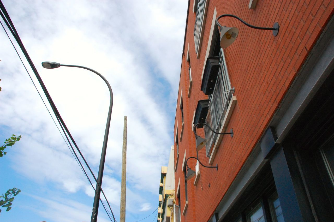 low angle view, sky, building exterior, built structure, street light, cloud - sky, architecture, no people, outdoors, day, city