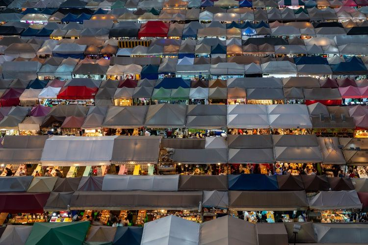 Night view of the train night market ratchada also known as talad nud rod fai in bangkok.