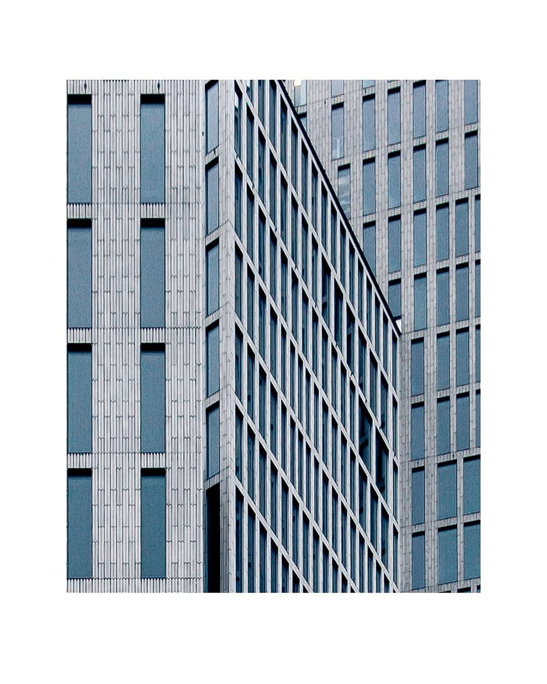architecture, built structure, building exterior, building, window, city, modern, office, office building exterior, glass - material, no people, blue, sky, outdoors, clear sky, pattern, day, control, geometric shape, reflection, skyscraper