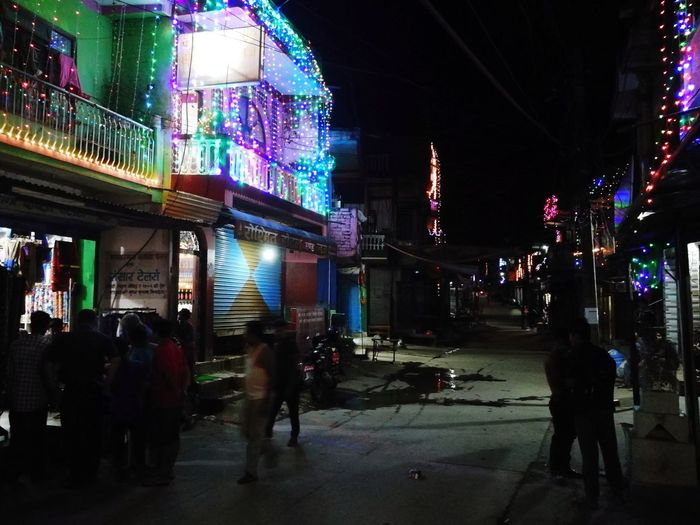 Night Illuminated City Street Street City Travel Destinations Large Group Of People Nightlife People Building Exterior Outdoors Architecture Adult Adults Only Crowd Neon Cityscape Only Men Traditional Festival Celebration Multi Colored Flame Tihar Festival Of Light And Colour Hinduism Hindu Festival