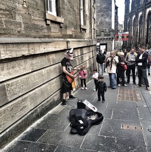 Building Exterior Busking City Life Cobblestone Day Depth Of Field Edinburgh Kids Large Group Of People Lifestyles Men Music Occupation Outdoors Pig Real People Scotland Selective Focus Sidewalk Street Streets The Way Forward Urban Walking Women