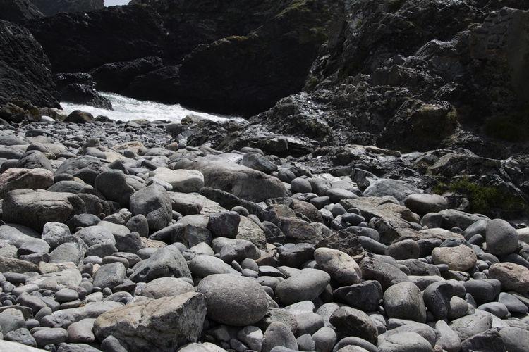 Stones on rocks at beach