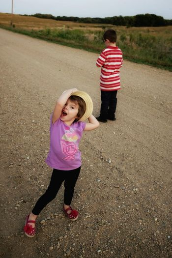 A Day In The Life Kids Being Kids Backroads Walking Around Farmland Color Photography Candid Portrait Gravel Road My Neighborhood Enjoying Life Real People Outsiderin