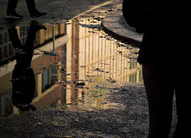 Encounter Puddleography Silhouettes Architecture Darkness And Light Encounters Outdoors Puddle Real People
