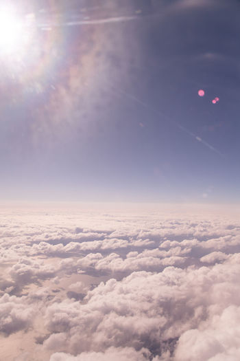 en route to Iceland Plane View Airplane View Plane Rainbow Lens Flare Purple Sky Pastel Sky Astronomy Airplane Flying Space Planet Earth Blue Above Lens Flare Sky Sky Only Plane Heaven Cumulonimbus