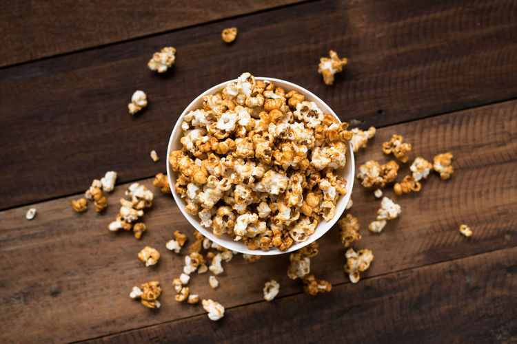 popcorn on wooden table background Family Homemade Natural Light Popcorn Snack Aroma Background Bowl Caramel Cinema Day Eat Flavored Food Gourmet Lifestyles Movıe No People Pile Sweet Table Tasty Treat Wooden Yellow